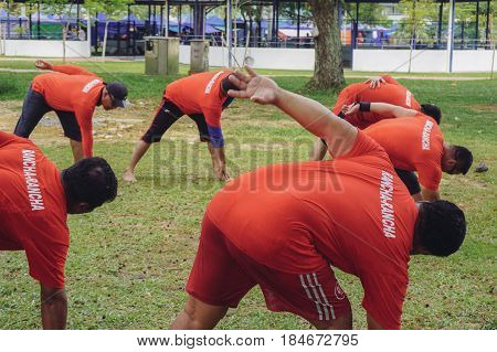 Labuan,Malaysia-April 29,2017:Group of sportman doing streching in the park on an early morning in Labuan,Malaysia.The government to encourage & support Malaysian to conveniently participate in sports.