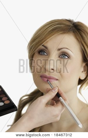 Young Blond-haired Female Having Her Make Up Done By A Make Up Artist