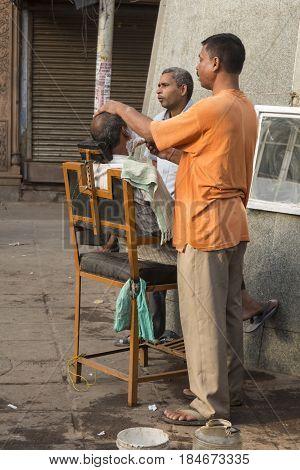 DELHI INDIA - JUN 7 : morning street barber at chawri bazar in Old Delhi of delhi on june 7 2015 india.