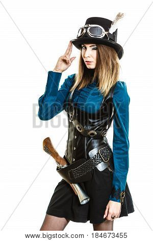 Young steampunk islolated girl winking on white wearing fancy hat. Fantasy old fashion with stylish topper goggle and gun.