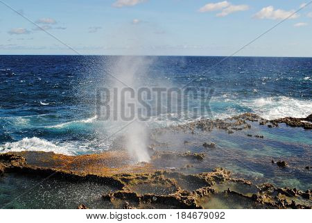 Geyser at Tinian Blow hole A small spray of water comes out of the blow hole in Tinian, Northern Mariana Islands