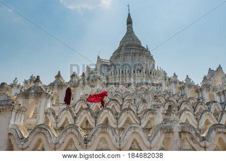 Myanmar The Novice Monk Walking On The White Pagoda In Mandalay Myanmar