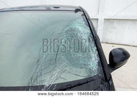 Broken car windshield. Accident of black car