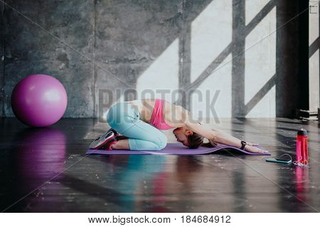 Side View Of Mature Yogini Stretching Lower Back And Spine. Woman Doing Upward Facing Dog Yoga Pose.