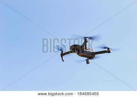 Unmanned Aerial Vehical With Video Camera Hovers In The Air. This Is Dji Mavic Pro Model.