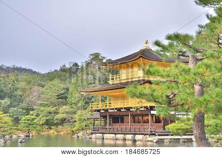 Kinkaku-ji Temple with Japanese garden in Kyoto, Japan. The Golden Pavilion (Kinkaku) is a three-story building on the grounds of the Rokuon-ji temple complex.