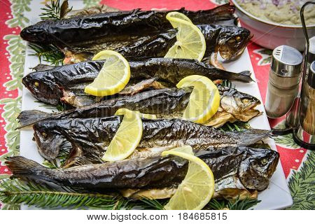 Smocked fish with lemon and pine tree branches