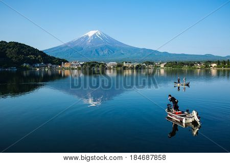 Yamanashi Prefecture Japan-May 22 2516- Fishing on Kawaguchiko lake and mount Fuji background.