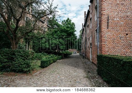 Leuven Belgium - July 30 2016: Green Park. The Grand Beguinage of Leuven is a well preserved and completely restored historical quarter is owned by the University of Leuven and used as a campus.