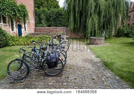 Leuven Belgium - July 30 2016: The Grand Beguinage of Leuven is a well preserved and completely restored historical quarter is owned by the University of Leuven and used as a campus. Bicycles parked