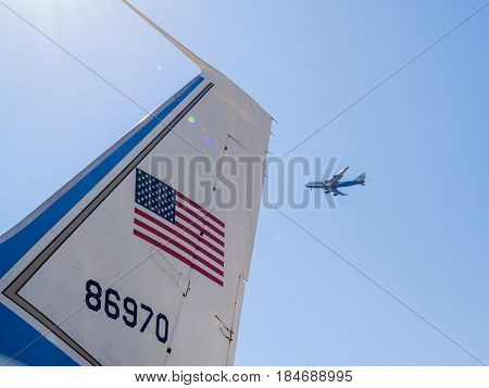 Seattle, USA - July 21, 2008; Tail, US flag and number of Airforce One airplane with passenger plane flying past at Museum of Flight Seattle.