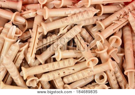 Some new red plastic dowel close up