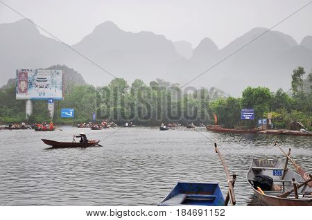 Tourist Boats Lined Up In Yen Stream At The Wharf. Perfume Pagoda, Vietnam