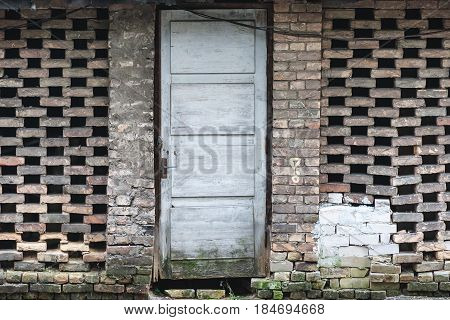 old barn brick wall and wooden door