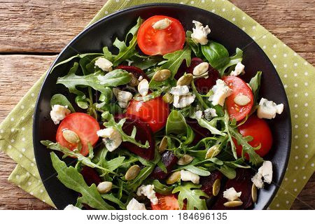 Healthy Salad With Beetroot, Arugula, Tomatoes, Roquefort Cheese And Seeds Close-up. Horizontal Top