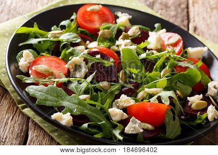 Healthy Salad With Beetroot, Arugula, Tomatoes, Roquefort Cheese And Seeds Close-up. Horizontal