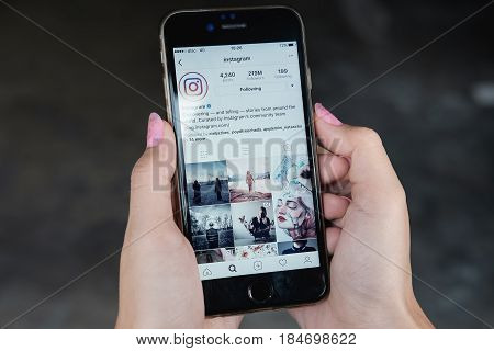 CHIANG MAI THAILAND - April 6 2017: A woman holds Apple iPhone 6S with Instagram application on the screen. Instagram is a photo-sharing app for smartphones.