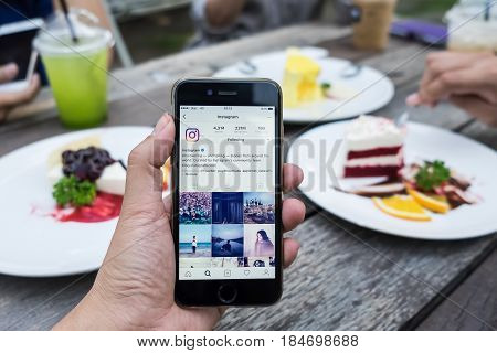 CHIANG MAI THAILAND - April 30 2017: A woman holds Apple iPhone 6S with Instagram application on the screen. Instagram is a photo-sharing app for smartphones.