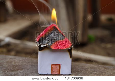 Home on Fire House Model, risk or property Insurance Protection.