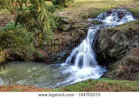 Small waterfalls in a wood suitable as a cover or background
