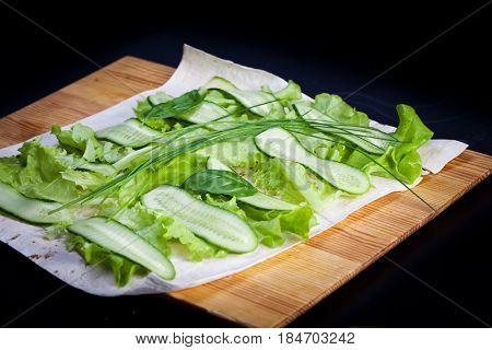 Roll pita with salad and salted salmon