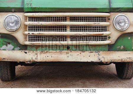 Old rusted van front. Retro vintage vehicle. Trip
