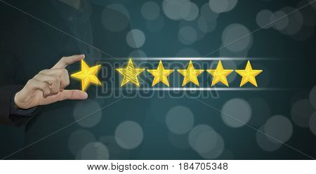 Business hand select yellow marker on five star rating. concept customer service excellent.