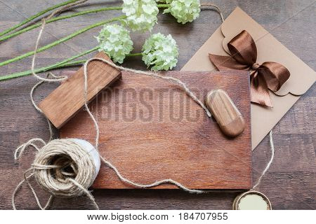 Wooden box on the table with elements Wooden box for inscription and an envelope for a disc lavatory bow ribbon brown color flowers design gift