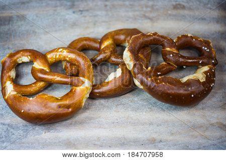 Brezen on wooden background bakery traditional, bavarian