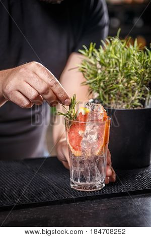 Bartender Is Decorating Cocktail