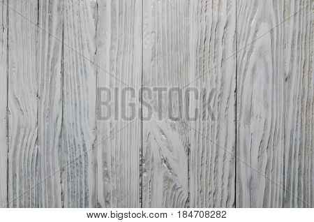 Old textural background painted in white close-up vertical slats
