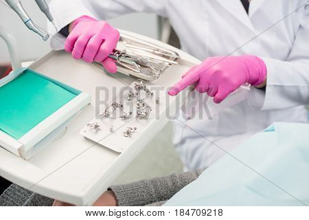 Dentist With Gloved Hands Is Working With Dental Tools In Dental Office. Dentistry. Close-up