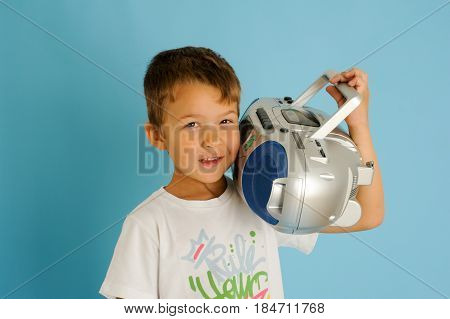 Boy Listening At Music From A Stereo