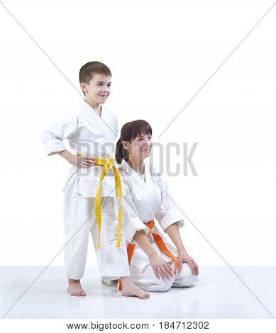 Athletes mother and son in karategi on the white background