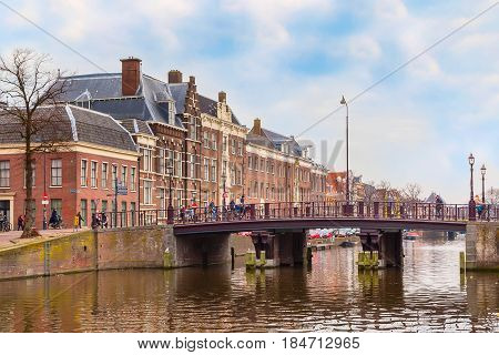 Haarlem, Netherlands - April 2, 2016: Picturesque landscape with beautiful traditional houses near canal, Haarlem, Holland