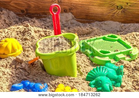 sandbox with toys in sand on children playground