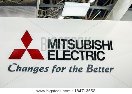 Moscow, Russia - February, 2016: Mitsubishi Electric company logo on the wall. Mitsubishi Group Japanese multinational companies in a variety of industries