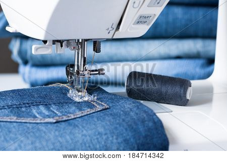 Sewing Machine Sew Jeans Fabric Close Up.