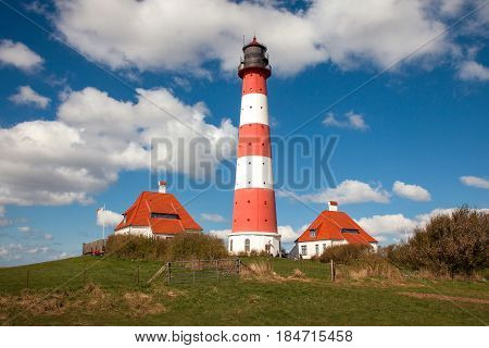 View of famous Westerhever lighthouse at North Sea coast Germany