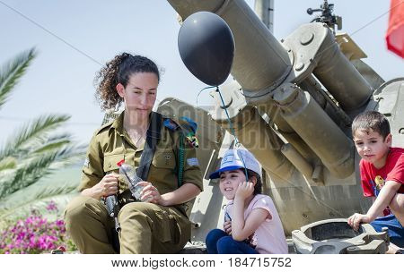 Unidentified Israeli Girl-soldier  Sit On Tank Armour With Childs At Latrun Armored Corps Museum