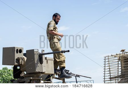 Unidentified Israeli Soldier Stand On Tank Armour At Latrun Armored Corps Museum