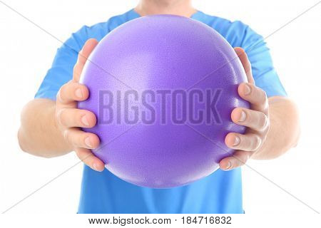 Man with rubber ball on white background, closeup
