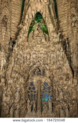 Barcelona Spain - September 22 2015: Nativity facade central part at basilica of Sagrada Familia at night.