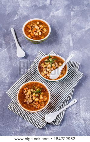 Meat soup with beans and vegetables. Selective focus