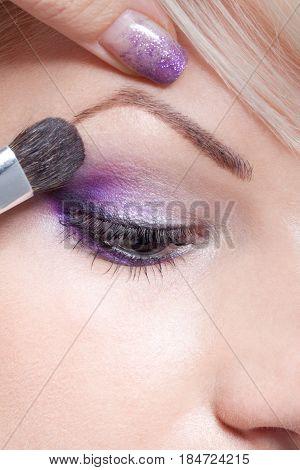 Makeup Artist Applying Eyeshadow