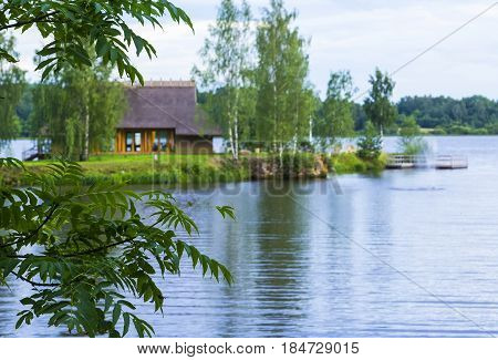 View background landscape house cottage private hotel for rest on the island on the Daugava river in Latvia