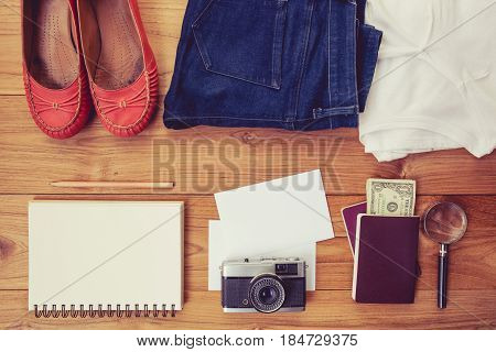 Vintage tone of Outfit of traveler student teenager young woman. Overhead of essentials for a person.