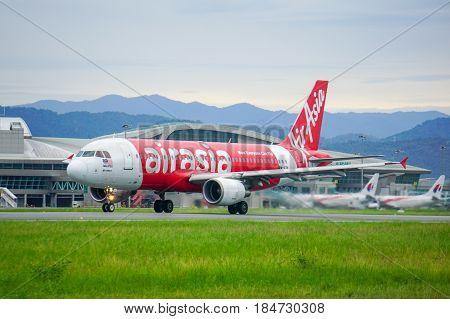 Kota Kinabalu,Sabah-June 18,2016:AirAsia aircraft landed at Kota Kinabalu International Airport in Kota Kinabalu,Sabah.AirAsia Berhad is a Malaysian low cost airline headquartered near Kuala Lumpur,Malaysia.