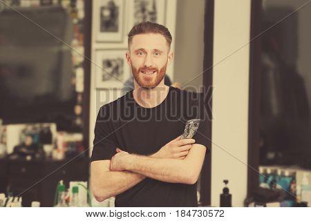 Professional hairdresser at barbershop