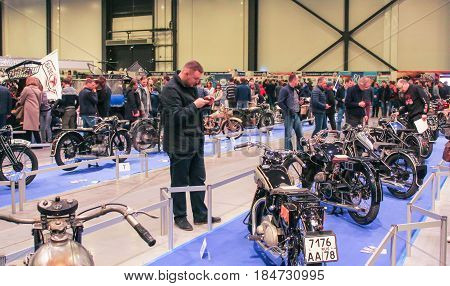 St. Petersburg Russia - 15 April, Visitors to the motor show,15 April, 2017. International Motor Show IMIS-2017 in Expoforurum. Visitors and participants of the annual moto-salon in St. Petersburg.